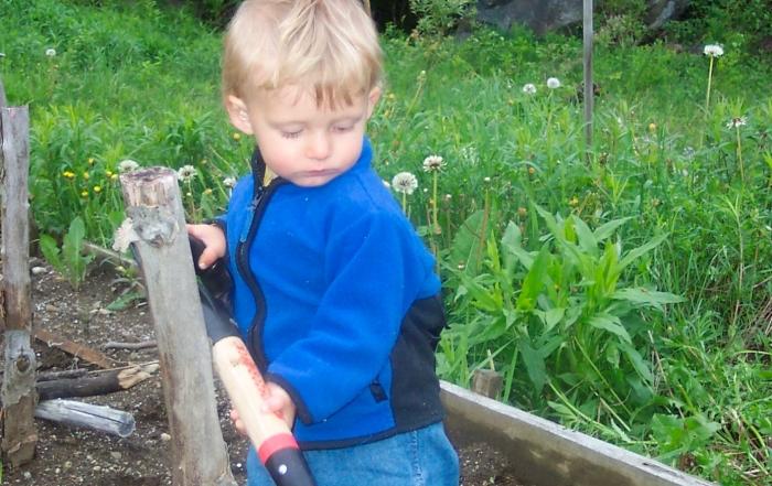 corbin in garden digging